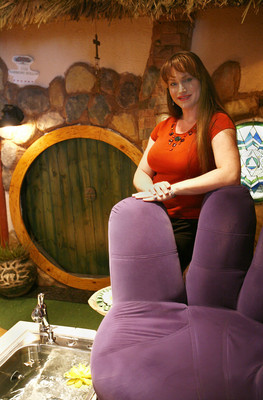 "SE-COMMERCIALCENTER--Paula Sadler, owner of A Harmony Nail Spa and president of the Commercial Center Business Association, stands next to a giant purple hand chair, while a spa foot bath runs in the foreground. The ""hobbit hole"" (background) is one of the features of the spa.  Commercial Center is located at 953 E. Sahara Ave. 6/6/08 View photo by Dale Dombrowski"